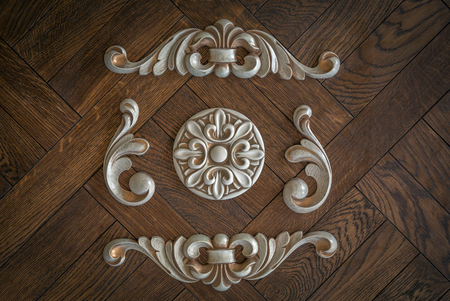 Wood processing. Joinery work. woodcarving. carved detail on a wooden background. used as background Banco de Imagens