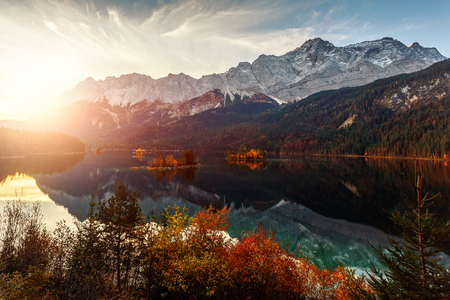 Wonderful sunset at the famous lake Eibsee. right below Zugspitze, Germany's highest mountain. Location resort Garmisch-Partenkirchen Bavarian alp, Germany. Europe. travel concept. light effect.