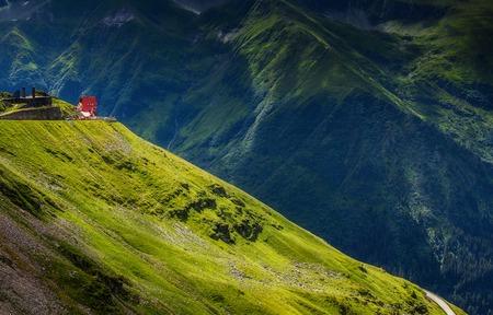 Incredible Alpine highland under sunlight. Unsurpassed sunrise in the mountains. Breathtaking nature landscape.  Europe, Romania. Stock Photo
