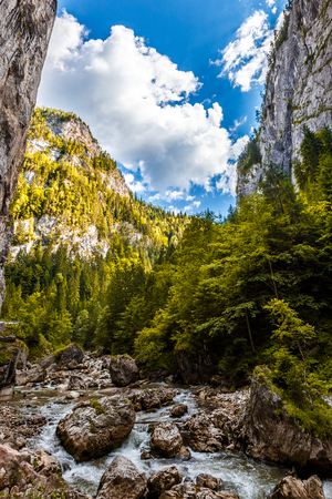 wonderful sunny mountain scenery. river in canyon in mountans gloving in sunlight. gorgeus unusual scene. Romania- Carpathian Mountains. Bicaz Canyon Cheile Bicazului . Beauty in the world. soft light effect