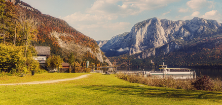 Awesome Alpine Landscape. Austrian Village with Roky Mountain on Background, incredible Autumn Scenery. Amazing Natural View. Salzkammerguts Mountains. Austria. Europe. Instagram Filter