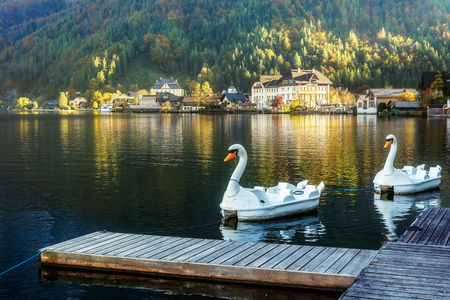 Famous Hallstatt with lake and touristic boats surrounded by Rocky Mountains. of Sunny Day. Picturesque view of nature. Salzkammergut, Upper Austria. Austrian Alps. wonderful picturesque Scene
