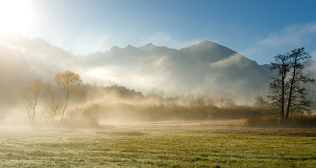 Foggy Sunrise in Mountains. Dramatic Picturesque Scene. Autumn in Nature. Rural Landscape. Beautiful Alpine View. Europe. Wonderful Nature in the world Archivio Fotografico