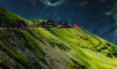 Incredible Alpine highland under sunlight. Unsurpassed sunrise in the mountains. Breathtaking nature landscape.  Europe, Romania. Transfagarasan road, Beauty in the world. Picture of wild area Stock Photo
