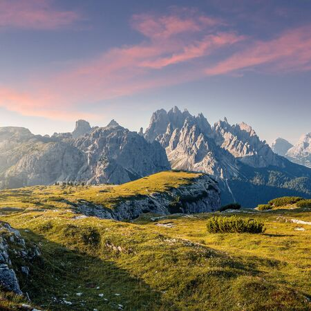 Wonderful Alpine highlands during sunrise. Morning view of Dololites mountains, Italian Dolomites Alps under sunlight. Awesome landscape with colorful sky over the Cadini di Misurina range.