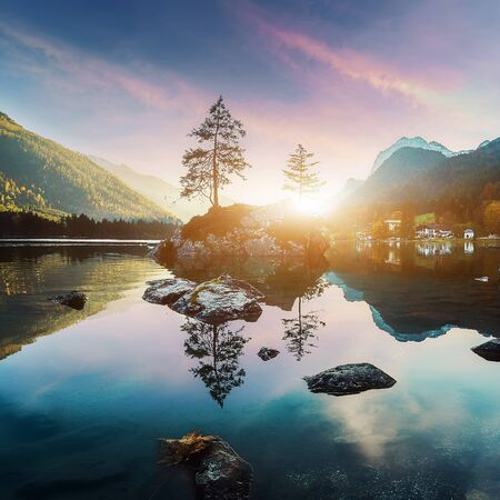 Awesome Sunny nature landscape. Impressively beautiful Hintersee lake at sunrise. best popular location for photographer in World. view of German Alps, Bavarya, Europe. Natural Background