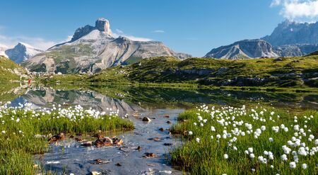 Awesome mountains landscape with lake in summer. Colorful sunny scene in the Tre Cime di Lavaredo National Park. Dolomite Alps, South Tyrol, Auronzo