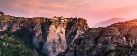 Fantastic Landscape with monasteries and rock formations in Meteora during sunset, Greece. Mysterious Sunny Morning with colorful sky. Awesome Nature Landscape. Popular travel locations. Standard-Bild