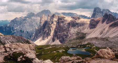 Panoramic view of famous Dolomites mountain peaks and lakes near Famouse Tre cime di Lavaredo peaks. Wonderful summed day. panoramic landscape of mountainous countryside. Dolomite. Italy