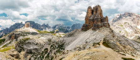 National Nature Park Tre Cime In the Dolomites Alps. Beautiful nature of Italy. unsurpassed View of Mountains Range and overcast sky, Stunning nature scenery and scenic travel destination. Panorama Standard-Bild