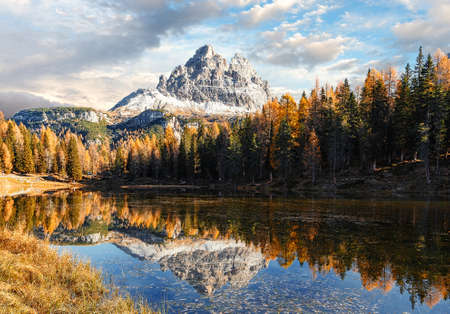 Beautiful landscape of alpine lake under bright sunlight. Incredible nature Landscape of Dolomites Alps. Impessive Beautiful View on Mountain Lake Antorno in Autumn. popular Travel destination