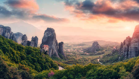 Wonderful Panoramic view of the rocks and monasteries of Meteora, Greece. Mysterious Sunny Morning with colorful sky, during sunrise. Awesome Nature Landscape. Amazing Greece. Popular travel locations