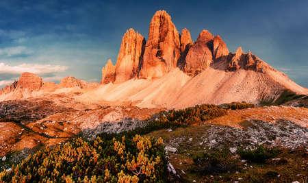 Fantastic Nature Landscape. Beautiful view of famous Tre Cime di Lavaredo peak in Dolomites mountain range under sunlit during sunset. Popular travel destination. Amazing nature Background. panorama