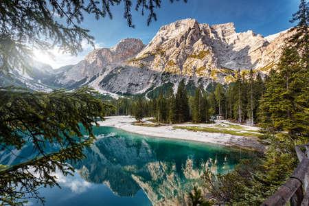 Impressive view of Lago di Braies at sunrise. Trentino Alto Adidge, Dolomites mountains, South Tyrol, Italy, Europe. Incredible Nature Landscape. Braies lake, Pragser wildsee at springtime