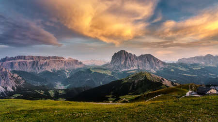Landscapes Dolomites Alps during sunset. Majestic Mountains peaks with Colorful sky. Dramatic unusual scene. Picturesque Sky over the Langkofel Peaks. Wonderful picturesque Scene. Postcard Standard-Bild