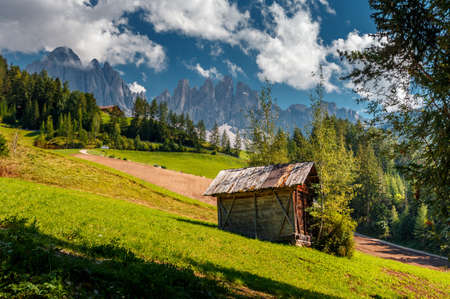 Awesome sunny Landscape. Dolomite Alps. Napure Background. Santa Maddalena village in front of the Geisler or Odle Dolomites Group, Val di Funes, Val di Funes, Trentino Alto Adige, Italy, Europe.