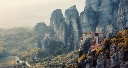 Monasteries on the top of rock in a summer day in Meteora, Greece. incredible sandstone rock formations. The Holly Monastery of Rousanou and St. Nikolaos Anapafsas Monastery. Nature Landscape