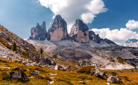 Wonderful Panorama View of dolomites Alps. World famous peaks of Tre Cime di Lavaredo National park. Awesome Alpine highlands in sunny day. Amazing Nature landscape. Best beautiful place in the World.