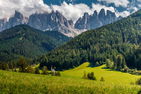 Incredible Nature landscape. Famous alpine place of the world, Santa Maddalena village with magical Dolomites mountains in background, Val di Funes valley, Trentino Alto Adige region, Italy, Europe.