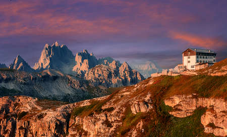 Fantastic Nature Landscape. Beautiful view of famous Tre Cime di Lavaredo park in Dolomites mountain range with famous alpine hut during sunrise. Popular travel destination. Amazing nature Background
