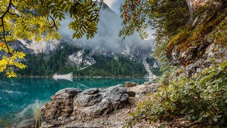 Incredible Nature Landscape. Braies Lake in Dolomites mountains with mornitg fog, Dolomite. Italy. Italian lake landscape. Standard-Bild