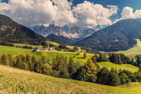 Awesome alpine Landscape in sunny day. Santa Maddalena. Is one of the most popular photo spot of Dolomite. Famous World place. Dolomites Alps. Italy. Amazing Natural background. Postcard.