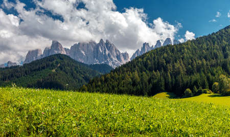 Awesome sunny Landscape. Dolomite Alps. Napure Background. Santa Maddalena village in front of the Geisler or Odle Dolomites Group, Val di Funes, Val di Funes, Trentino Alto Adige, Italy, Europe