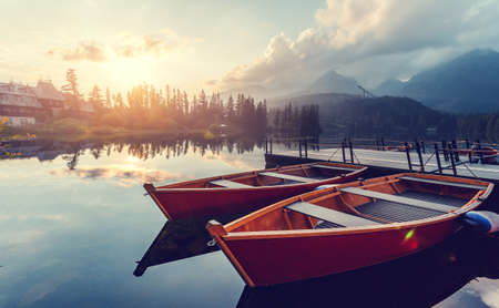 Amazing lake Strbske Pleso during Sunrise. Creative image. Wonderful Autumn landscape. Picturesque view of nature. Amazing natural Background. Popular Travel Destinations. High Tatras. Slovakia.