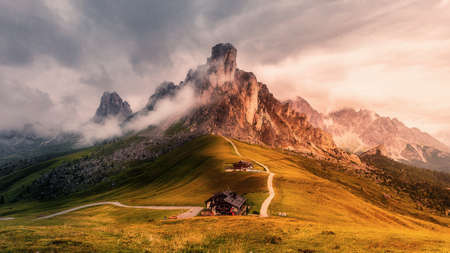 Awesome nature landscape. fantastic view of famous Dolomites mountain peaks glowing in beautiful golden morning light at sunrise in summer. Passo Giau, Dolomites, Italy. Majestic Dolomites Alps.