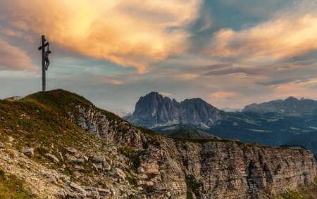 Epic dramatic scene with colorful sky. Landscape of Dolomites Alps. Majestic Sassolungo Peak During Sunrise. Location place Puez-Odle National Park, Gardena, Geisler. Tyrol, Italy, Europe.
