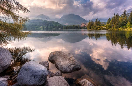 Wonderful Nature landscape. Awesome sunny day at Strbske Pleso Lake. Scenic image of fairytale landscape in sunlit with reflections. Autumn view at mountain lake. Beauty in the world.  Slovakia.