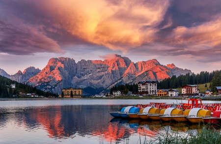 Misurina Lake in the Dolomites mountains in Italy near Auronzo di Cadore during sunset. Fantastic Sunrise over Misurina Lake with Dramatic Colorful sky. Amazing Nature Landscape. Beautiful world