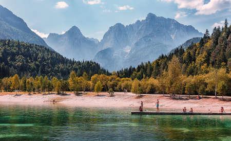 Jasna lake in Julian Alps, Kranjska gora. Wonderful summer landscape of Triglav National Park. Sunny scene of Julian Alps, Gozd Martuljek location, Slovenia, Europe. Awesome Nature Scenery Standard-Bild