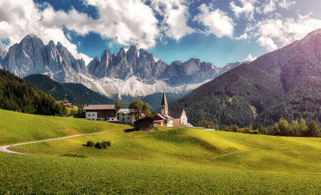 Wonderful Summer mountains landscape. Impessive Dolomites Alps. Santa Maddalena village with majestic Dolomites mountains in background, Val di Funes valley, Trentino Alto Adige region, Italy, Europe