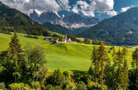 Awesome alpine Landscape in sunny day. Santa Maddalena. Is one of the most popular photo spot of Dolomite. Famous World place. Dolomites Alps. Italy. Amazing Natural background. Postcard