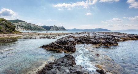 Seashore with cliffs, A scenic landscape photo of the beautiful Corfu island coastline. Wonderful view of Kanoula beach. Greece. Scenic nature sunny day above sea. Seascape background 版權商用圖片