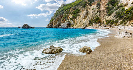 Scenic nature Seascape. Landscape of Ionian Sea. Seashore with cliffs, waves crashing on rocks. Adventures and exotic travel concept. Wonderful summer view. Amazing Natural Background