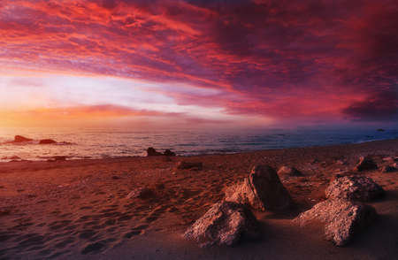 Colorful colorful seascape during sunset. Incredible nature Landscape. Amazing beach sunset with Picturesque sky. Unsurpassed sunrise over the Ionian Sea. Wonderful view of Avali Beach. Greece