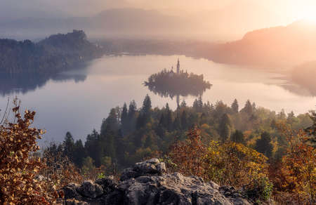 Fantastic Misty morning over the Fairy tale mountain lake. Amazing View On Bled Lake during sunrise. Wonderful nature scene. Adventures and travel concept. Awesome spring landscape. Slovenia.