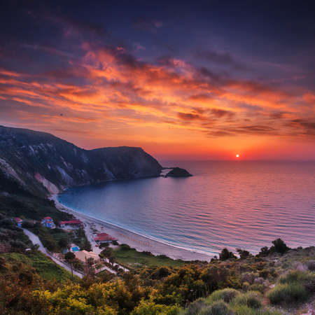 Incredible view of Petani Beach during sunset. Fantastic sunset on Cephalonia Island, Greece, Europe. Impressive evening seascape of Mediterranen Sea. Wonderful nature scene of Ionian sea. postcard. 版權商用圖片