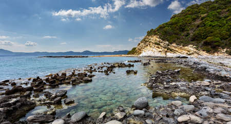 Seashore with cliffs, A scenic landscape photo of the beautiful Corfu island coastline. Wonderful view of Kanoula beach. Greece. Scenic nature sunny day above sea. Seascape background.