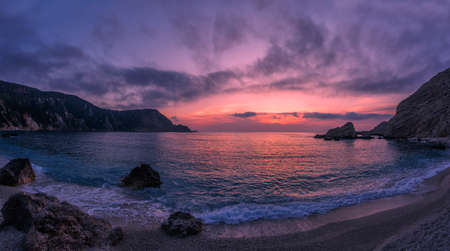 Incredible picturesque seascape during sunset, Awesome Nature Landscape. Dramatic colorful sky over the calm ocean. Landscape of Ionian Sea. Seashore with cliffs, waves crashing on rocks. Greece 版權商用圖片