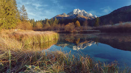 Awesome alpine highlands in sunny day. Scenic image of fairy-tale Landscape in sunlit with Majestic Rock Mountain on background. Wild area. amazing nature scenery. Incredible places in the world.