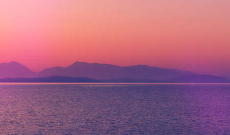 Fantastic seascape with colorful sky during sunset. nature in twilight period during sunset over the sea and the nice mountains silhouette. Fantastic nature background 版權商用圖片