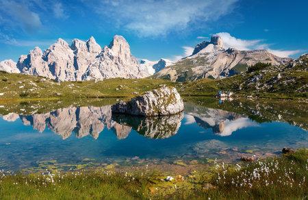 Impressively beautiful Fairy-tale mountain lake in Italian Alps. Breathtaking Scene. Panoramic view of beautiful mountain landscape in Alps with Lake. Incredible Dolomites Alps In Sunny Day.