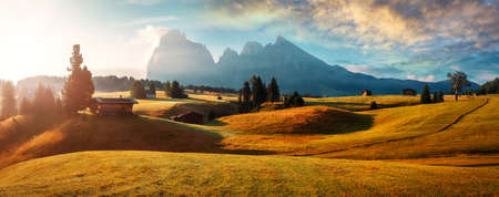 Wonderful Landscape with colorful sky. Seiser Alm (Alpe di Siusi) with Langkofel mountain at sunrise, Italy. Dolomites, Trentino Alto Adige, South Tyrol, Italy, Europe. Popular travel destination.