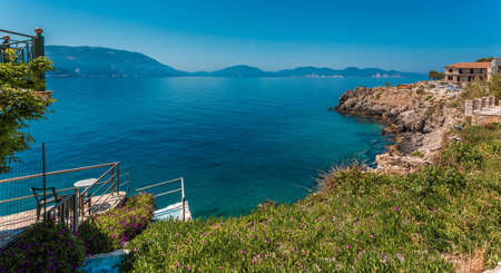 Wonderful summer seascape of Ionian Sea. Wonderful place for holiday. Amazing Greece. Picturesque colorful village Assos in Kefalonia. Turquoise colored bay in Mediterranean sea. Aerial view .. 版權商用圖片