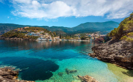 Wonderful summer seascape of Ionian Sea. Wonderful place for holiday. Amazing Greece. Picturesque colorful village Assos in Kefalonia. Turquoise colored bay in Mediterranean sea. Aerial view