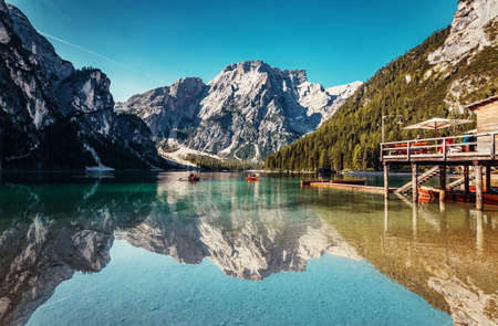 Braies lake during sunrise, popular Touristic Place in Dolomites Alps. Italy Picture of wild area Europe. Wonderful nature Landscape.