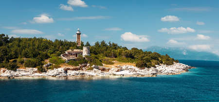 Old Venetian lighthouse in the Fiskardo port. Wonderful Sunny seascape of Ionian Sea, Kefalonia island. Greece. 版權商用圖片